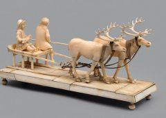 """Скульптурная композиция из моржовой кости """"Северные олени, везущие в санях женщину с младенцем"""""""